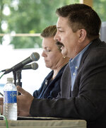 FILE - In this Wednesday, July 25, 2018, file photo, Randy Bryce answers a question during a debate with his opponent, Cathy Myers, at the Rock County 4-H Fair in Janesville, Wis. House Speaker Paul Ryan's retirement creates an opening in his southeastern Wisconsin congressional district for the first time in 20 years, fueling hopes among Democrats that they can pick up the seat that leans Republican. (Angela Major/The Janesville Gazette via AP, File)
