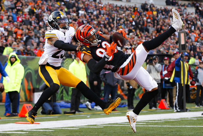 Cincinnati Bengals wide receiver Tyler Boyd (83) catches a touchdown pass against Pittsburgh Steelers cornerback Joe Haden (23) during the first half an NFL football game, Sunday, Nov. 24, 2019, in Cincinnati. (AP Photo/Frank Victores)