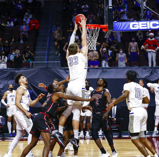 Grand Canyon's Asbjorn Midtgaard (33) dunks against New Mexico State during the second half of an NCAA college basketball game for the championship of the Western Athletic Conference men's tournament Saturday, March 13, 2021, in Las Vegas. (AP Photo/Chase Stevens)