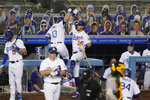 Los Angeles Dodgers' Max Muncy (13) celebrates his two-run home run with Cody Bellinger (35) during the third inning of the team's baseball game against the Oakland Athletics on Wednesday, Sept. 23, 2020, in Los Angeles. (AP Photo/Marcio Jose Sanchez)