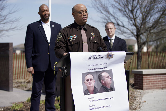 Capt. Wayne Hudson of the Douglas County Sheriff's office speaks at a news conference in Omaha, Neb., Wednesday, April 1, 2020, to announce that Ronald Penzkowski a former director of communications for then-Omaha Mayor Jim Suttle a decade ago, was arrested on suspicion of making terroristic threats and stalking. Investigators say that Penzkowski sent at least 15 email messages to Dr. Adi Pour, Douglas County Health Director, threatening to