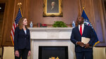 Judge Amy Coney Barrett, President Donald Trumps nominee for the U.S. Supreme Court, meets with Sen. Tim Scott, R-S.C., on Capitol Hill in Washington, Wednesday, Sept. 30, 2020. (Shawn Thew/Pool via AP)