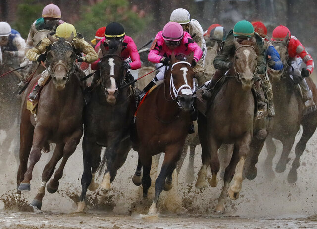 FILE - In this May 4, 2019, file photo, front row from left: Flavien Prat on Country House, Tyler Gaffalione on War of Will, Luis Saez on Maximum Security and John Velazquez on Code of Honor compete in the 145th running of the Kentucky Derby horse race at Churchill Downs in Louisville, Ky. (AP Photo/John Minchillo, File)