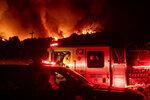Firefighters prepare to battle the Bond Fire burning through the Silverado community in Orange County, Calif., on Thursday, Dec. 3, 2020. (AP Photo/Noah Berger)