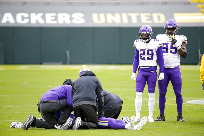 Minnesota Vikings' Cameron Dantzler is injured during the first half of an NFL football game against the Green Bay Packers Sunday, Nov. 1, 2020, in Green Bay, Wis. (AP Photo/Mike Roemer)
