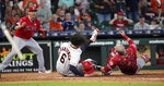 Houston Astros' Jake Marisnick, (6) collides Los Angeles Angels catcher Jonathan Lucroy (20) while trying to score during the eighth inning of a baseball game Sunday, July 7, 2019, in Houston. Marisnick was called out under the home plate collision rule. (AP Photo/David J. Phillip)