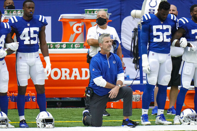 Indianapolis Colts head coach Frank Reich takes a knee during the National Anthem before an NFL football game against the New York Jets in Indianapolis, Sunday, Sept. 27, 2020. (AP Photo/AJ Mast)