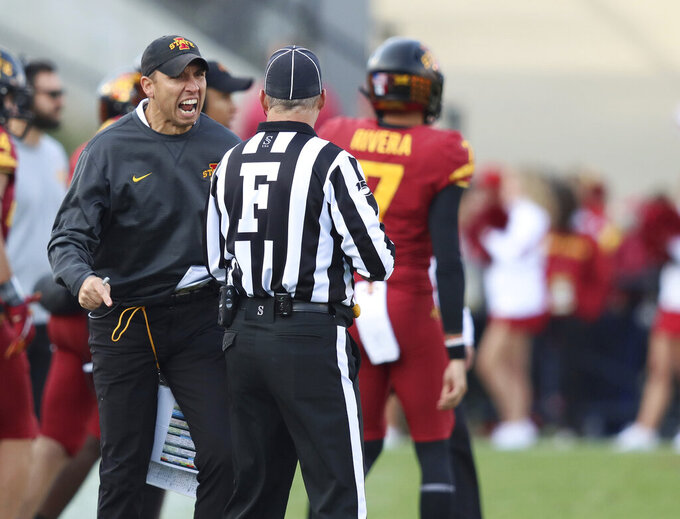 Iowa State head coach Matt Campbell, left, disputes a call with an official, denying Iowa State a first down during the second half of an NCAA college football game, Saturday, Oct. 26, 2019, in Ames, Iowa. Oklahoma State won 34-27. (AP Photo/Matthew Putney)