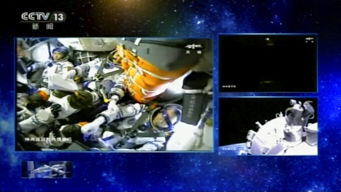 In this image taken from video footage run by China's CCTV, Chinese astronauts are seen aboard a Shenzhou-12 spaceship in space, Thursday, June 17, 2021. The Shenzhou-12 spaceship has docked with China's new space station at the start of 3-month mission, marking a milestone in the country's ambitious space program. (CCTV via AP Video)