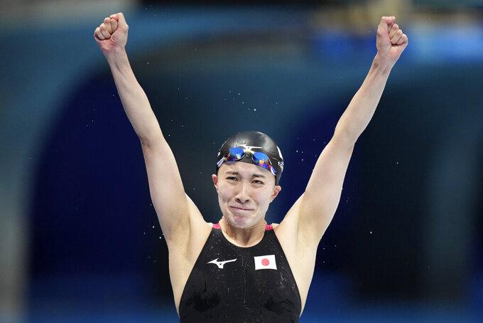 Yui Ohashi, of Japan, celebrates after winning the final of the women's 400-meter Individual medleyat the 2020 Summer Olympics, Sunday, July 25, 2021, in Tokyo, Japan. (AP Photo/Matthias Schrader)