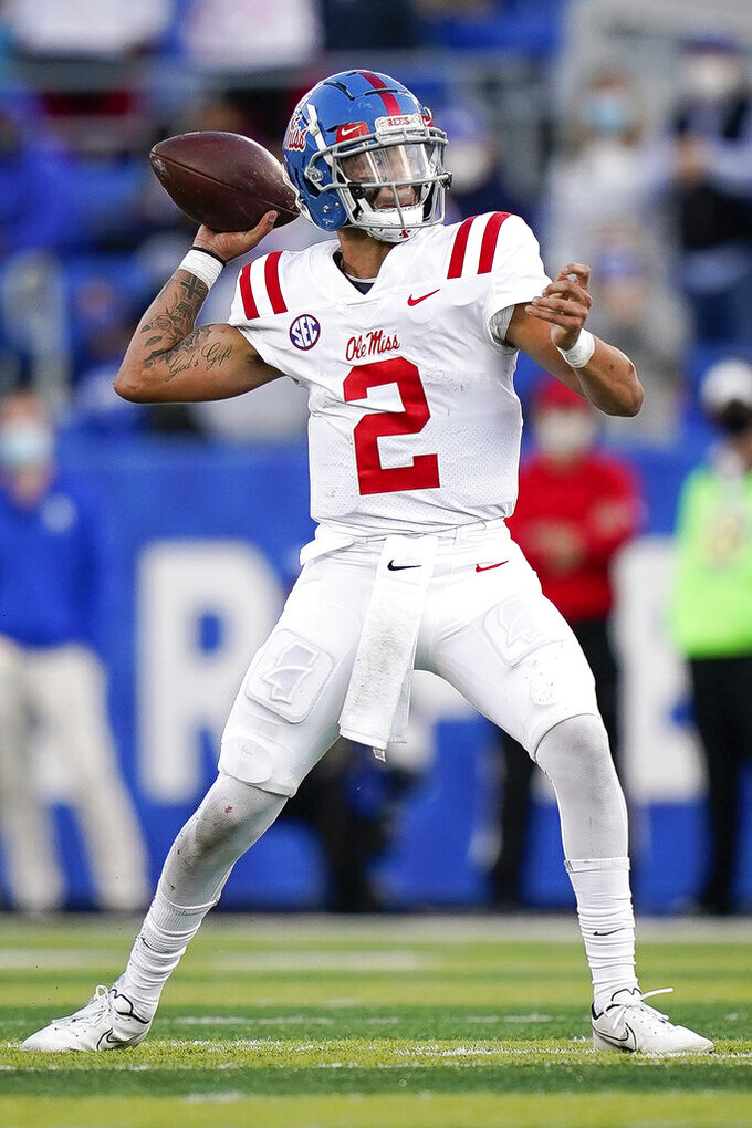 Mississippi quarterback Matt Corral (2) throws the ball during the second half of an NCAA college football game against Kentucky, Saturday, Oct. 3, 2020, in Lexington, Ky. (AP Photo/Bryan Woolston)