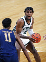 Michigan State's Aaron Henry, right, looks to drive against Notre Dame's Juwan Durham (11) during the second half of an NCAA college basketball game Saturday, Nov. 28, 2020, in East Lansing, Mich. Michigan State won 80-70. (AP Photo/Al Goldis)