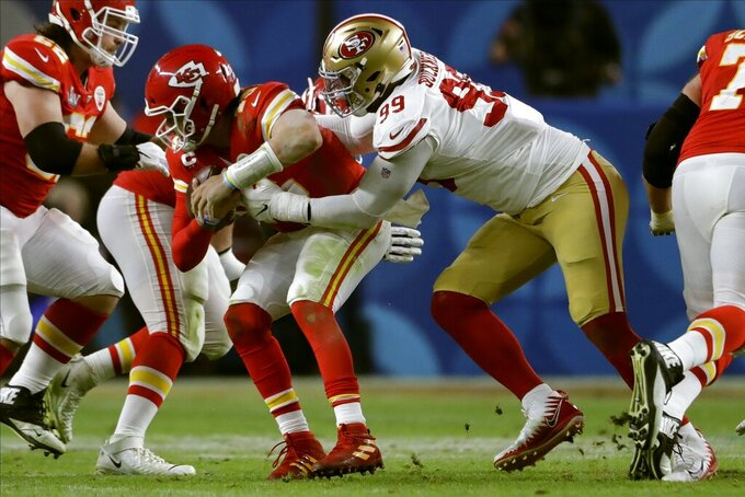 San Francisco 49ers' DeForest Buckner, right, sacks Kansas City Chiefs' quarterback Patrick Mahomes during the second half of the NFL Super Bowl 54 football game Sunday, Feb. 2, 2020, in Miami Gardens, Fla. (AP Photo/John Bazemore)