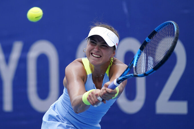 Rebecca Peterson, of Sweden, plays Elena Rybakina, of Kazakhstan, during the second round of the tennis competition at the 2020 Summer Olympics, Monday, July 26, 2021, in Tokyo, Japan. (AP Photo/Seth Wenig)