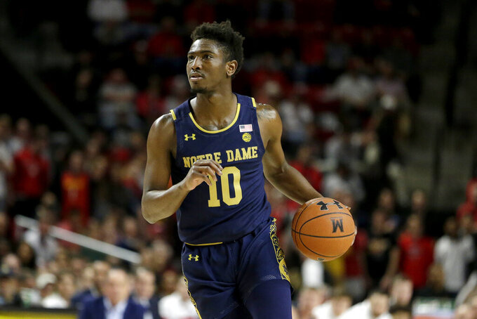 Notre Dame guard TJ Gibbs drives against against Maryland during the first half of an NCAA college basketball game, Wednesday, Dec. 4, 2019, in College Park, Md. (AP Photo/Julio Cortez)