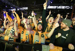 Fans celebrate as the name of Nashville's MLS team, Nashville Soccer Club, is announced during the unveiling of the team name, logo and colors Wednesday, Feb. 20, 2019, in Nashville, Tenn. The expansion franchise is due to start play in 2020. (AP Photo/Mark Humphrey)