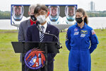 Hiroshi Sasaki, of Japan's Human Space Flight office, speaks to the media as he stands with Frank De Winne, left, of the European Space Agency, and NASA astronaut Tracy Caldwell Dyson during a news conference Wednesday, April 21, 2021, at the Kennedy Space Center in Cape Canaveral, Fla. Four astronauts will fly on the SpaceX Crew-2 mission to the International Space Station scheduled for launch on April 23, 2021. (AP Photo/Chris O'Meara)
