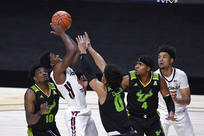 Virginia Tech's Nahiem Alleyne shoots against South Florida in the second half of an NCAA college basketball game, Sunday, Nov. 29, 2020, in Uncasville, Conn. (AP Photo/Jessica Hill)