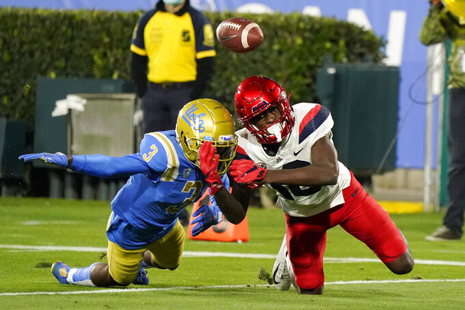 Arizona wide receiver Jamarye Joiner (10) cannot make a catch as UCLA defensive back Rayshad Williams (3) defends during the second half of an NCAA college football game Saturday, Nov. 28, 2020, in Pasadena, Calif. (AP Photo/Marcio Jose Sanchez)