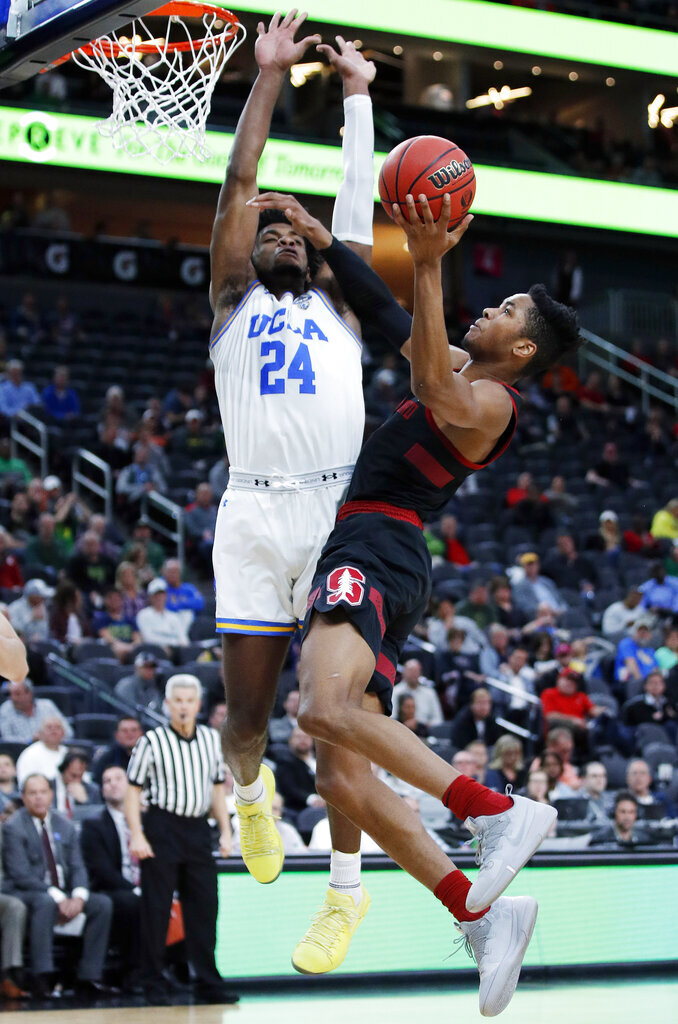 Stanford's KZ Okpala shoots against UCLA's Jalen Hill during the first half of an NCAA college basketball game in the first round of the Pac-12 men's tournament, Wednesday, March 13, 2019, in Las Vegas. (AP Photo/John Locher)