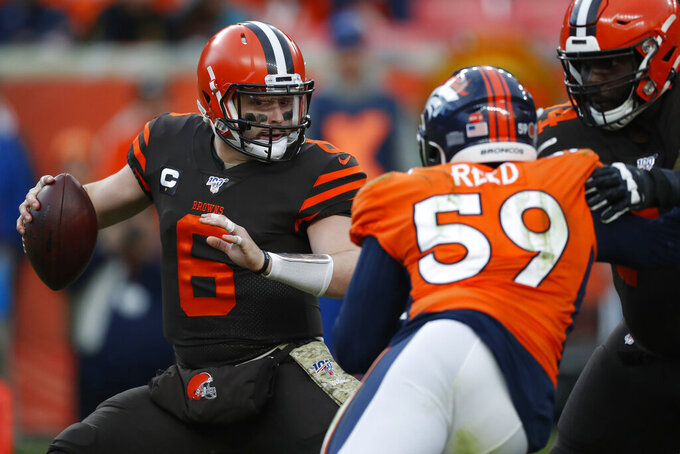Cleveland Browns quarterback Baker Mayfield (6) tries to elude Denver Broncos linebacker Malik Reed (59) during the second half of NFL football game, Sunday, Nov. 3, 2019, in Denver. (AP Photo/David Zalubowski)