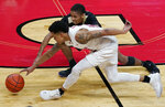 Rutgers guard Jacob Young, front, and Purdue guard Isaiah Thompson, rear, go after a loose ball during the second half of an NCAA college basketball game Tuesday, Dec. 29, 2020, in Piscataway, N.J. (AP Photo/Kathy Willens)