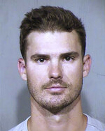 This Oct. 6, 2019, booking photo provided by the Maricopa County Sheriff's Office in Phoenix shows San Diego Padres pitcher Jacob Nix. Police say Nix was arrested for trying to crawl through the doggie door of a home in the Phoenix suburb of Peoria, Ariz. (Maricopa County Sheriff's Office via AP)