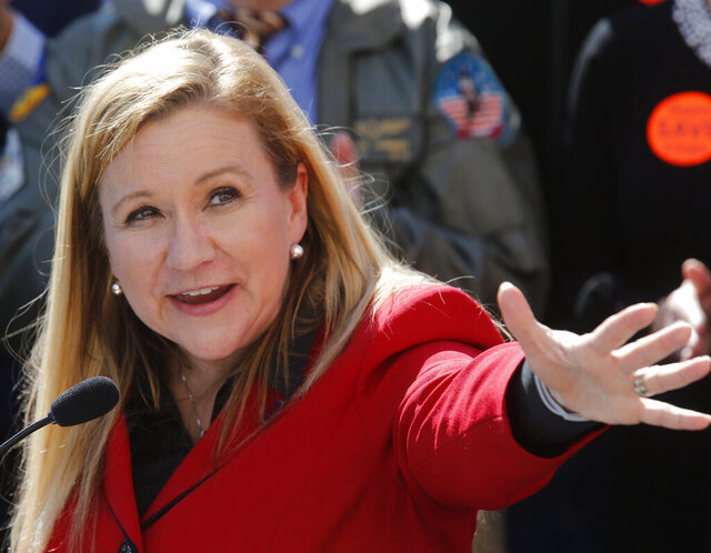 Sen. Amanda Chase, R-Chesterfield, announces that she is running for governor of Virginia in 2021, during a press conference outside the Virginia State Capitol in Richmond, Va., Monday, Feb. 17, 2020. (Bob Brown/Richmond Times-Dispatch via AP)