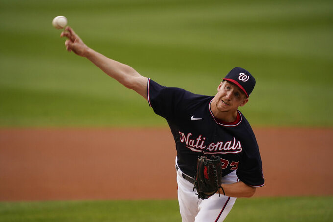 Washington Nationals' Erick Fedde delivers a pitch during the first inning of the team's baseball game against the New York Mets, Friday, June 18, 2021, in Washington. (AP Photo/Carolyn Kaster)