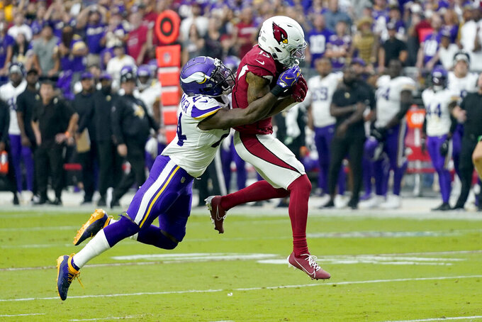 Arizona Cardinals wide receiver Christian Kirk (13) pulls in a catch as Minnesota Vikings cornerback Mackensie Alexander defends during the second half of an NFL football game, Sunday, Sept. 19, 2021, in Glendale, Ariz. (AP Photo/Ross D. Franklin)