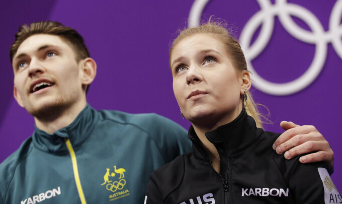 FILE - In this Wednesday, Feb. 14, 2018 file photo, Ekaterina Alexandrovskaya and Harley Windsor of Australia watch as their scores are posted after their performance in the pair figure skating short program in the Gangneung Ice Arena at the 2018 Winter Olympics in Gangneung, South Korea. Former world junior pairs figure skating champion Ekaterina Alexandrovskaya has died in Moscow, the Russian state news agency Tass reported Saturday, July 18, 2020 citing unnamed sources. Moscow police have yet to respond to a request for comment from The Associated Press. (AP Photo/Bernat Armangue, file)