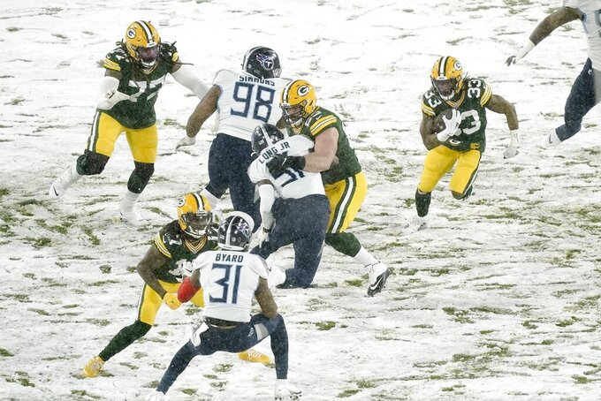 Green Bay Packers' Aaron Jones runs during the first half of an NFL football game against the Tennessee Titans Sunday, Dec. 27, 2020, in Green Bay, Wis. (AP Photo/Morry Gash)