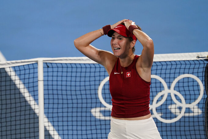Belinda Bencic, of Switzerland, reacts after defeating Marketa Vondrousova, of the Czech Republic, in the women's gold medal match of the tennis competition at the 2020 Summer Olympics, Saturday, July 31, 2021, in Tokyo, Japan. (AP Photo/Seth Wenig)