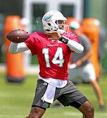Miami Dolphins quarterback Jacoby Brissett (14) throws during NFL football practice, Wednesday, Sept. 22, 2021 in Miami Gardens, Fla. (David Santiago/Miami Herald via AP)