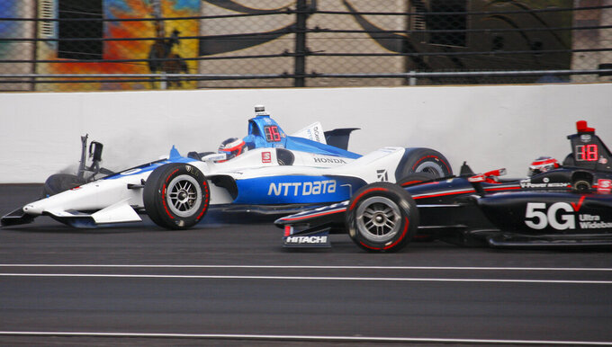 The Latest: O'Ward nearly goes airborne in crash at Indy