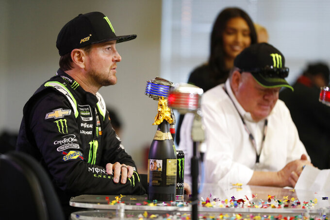Kurt Busch, left, responds to questions during a news conference as team owner Chip Ganassi, right, listens after announcing a multi-year contract Texas Motor Speedway in Fort Worth, Texas, Friday, Nov. 2, 2019. (AP Photo/Roger Steinman)