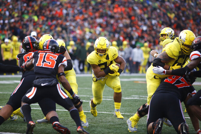 No. 11 Oregon-No. 16 Auburn opener 9 years after title game