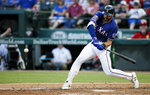 Texas Rangers' Joey Gallo makes contact for a solo home run during the fourth inning of a baseball game against the Houston Astros, Friday, July 12, 2019, in Arlington, Texas. (AP Photo/Brandon Wade)