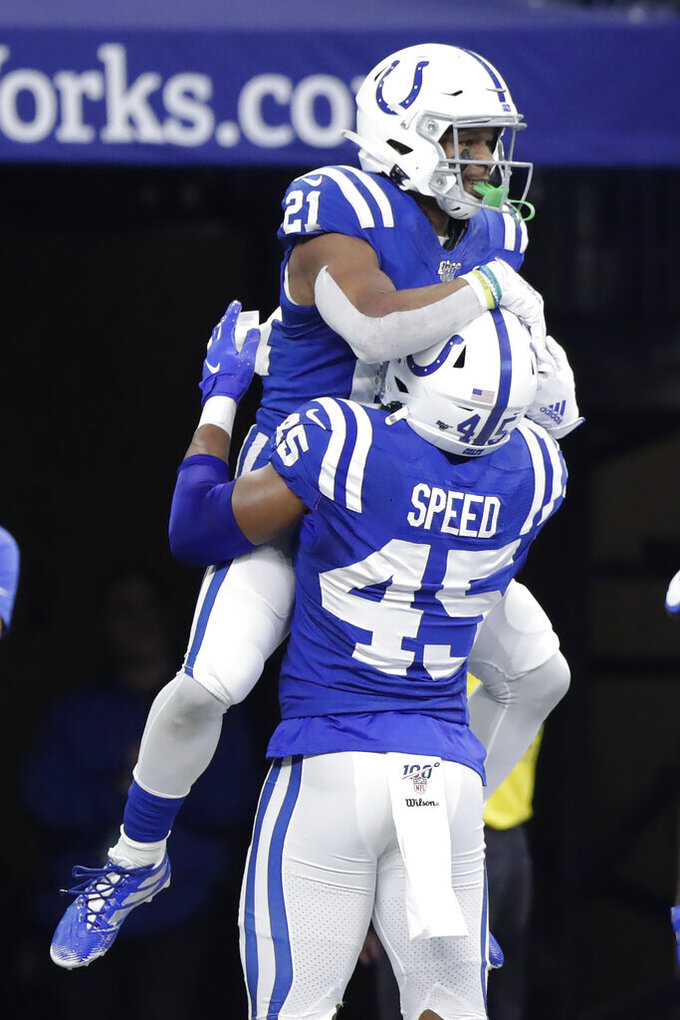 Indianapolis Colts' Nyheim Hines (21) celebrates with E.J. Speed (45) after running back a punt for a touchdown during the second half of an NFL football game against the Carolina Panthers, Sunday, Dec. 22, 2019, in Indianapolis. (AP Photo/Michael Conroy)