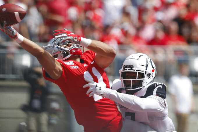 Cincinnati defensive back Coby Bryant, right, interferes with Ohio State receiver Austin Mack trying to catch a pass during the second half of an NCAA college football game Saturday, Sept. 7, 2019, in Columbus, Ohio. Bryant was penalized on the play. Ohio State beat Cincinnati 42-0. (AP Photo/Jay LaPrete)