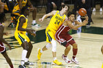 Baylor guard Matthew Mayer (24) taps the ball away from Oklahoma forward Jalen Hill, right, during the first half of an NCAA college basketball game on Wednesday, Jan. 6, 2021, in Waco, Texas. (AP Photo/Ray Carlin)