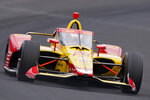 Ryan Hunter-Reay drives through the first turn during qualifications for the Indianapolis 500 auto race at Indianapolis Motor Speedway in Indianapolis, Saturday, May 22, 2021. (AP Photo/Michael Conroy)