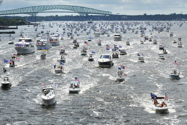 Hundreds of boats idle through downtown on the St. Johns River during a rally Sunday, June 14, 2020, in Jacksonville, Fla., celebrating President Donald Trump's birthday.  (Will Dickey/The Florida Times-Union via AP)