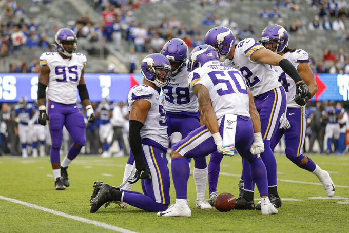 The Minnesota Vikings defense celebrates during the fourth quarter of an NFL football game against the New York Giants, Sunday, Oct. 6, 2019, in East Rutherford, N.J. (AP Photo/Adam Hunger)
