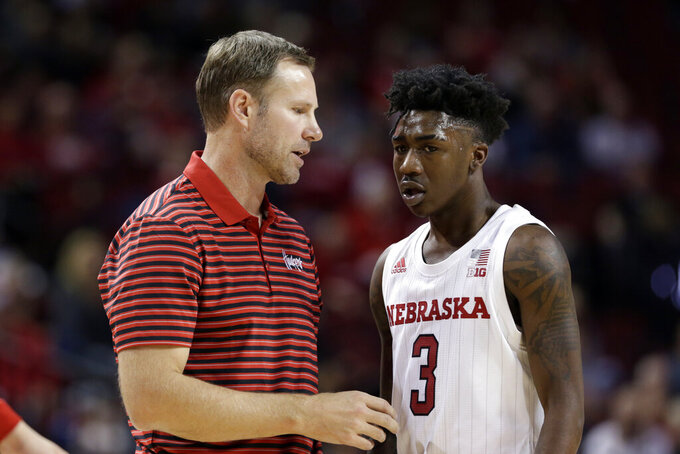 In this Wednesday, Oct. 30, 2019 photo, Nebraska coach Fred Hoiberg talks to Cam Mack (3) during an NCAA college basketball exhibition game against Doane University in Lincoln, Neb. Hoiberg knows the track record of Nebraska basketball coaches is not good. He wanted the job anyway. He takes over a program that has not won a conference championship in 70 years or ever won a game in the NCAA Tournament. He says a sold-out arena and top-notch facilities can trump the program's lack of tradition. (AP Photo/Nati Harnik)
