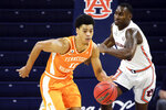 Tennessee guard Jaden Springer (11) brings the ball down court on a fit break against Auburn during the second half of an NCAA basketball game Saturday, Feb. 27, 2021, in Auburn, Ala. Auburn won 77-72. (AP Photo/Butch Dill)