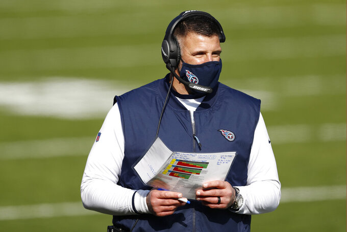 Tennessee Titans head coach Mike Vrabel walks on the sideline in the first half of an NFL wild-card playoff football game against the Baltimore Ravens Sunday, Jan. 10, 2021, in Nashville, Tenn. (AP Photo/Wade Payne)