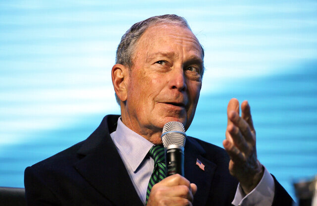 Democratic Presidential candidate and former New York City Mayor Michael Bloomberg gestures while taking part in an on-stage conversation with former California Gov. Jerry Brown at the American Geophysical Union fall meeting Wednesday, Dec. 11, 2019, in San Francisco. Bloomberg made his first visit to California as a Democratic presidential candidate, appearing earlier with the mayor of Stockton who's championed universal basic income. Bloomberg and Brown talked about America's Pledge, bringing together leaders to ensure the U.S. remains a global leader in reducing emissions and delivering the goals of the Paris Agreement. (AP Photo/Eric Risberg)