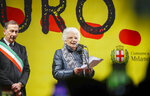 Liliana Segre, an 89-year-old Auschwitz survivor and senator-for-life, right, flanked by Milan's Mayor Giuseppe Sala speaks at an anti-racism demonstration in Milan's Victor Emmanuel II arcade in northern Italy that was joined by mayors of some 600 Italian towns, Tuesday, Dec. 10, 2019. In Italy, controversy flared recently when Segre called for the creation of a parliamentary committee to combat hate, racism and anti-Semitism after revelations that she is subject to some 200 social media attacks each day. (AP Photo/Luca Bruno)