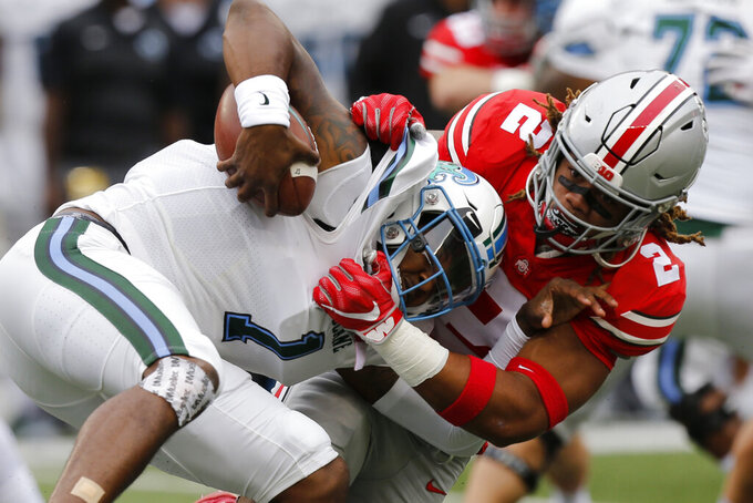 FILE - In this Sept. 22, 2018, file photo, Ohio State defensive end Chase Young, right, sacks Tulane quarterback Jonathan Banks during the first half of an NCAA college football game, in Columbus, Ohio. Chase Young is known to lead with his mouth. Being the loudest Buckeye on the field is part of the reason his teammates elected him a captain this season. The other part is that he can back it up the chattering. Young is Ohio State's best player, a 6-foot-5, 265-pound man with startling quickness and a mean streak who rarely stops cheering, cajoling and trash-talking. (AP Photo/Jay LaPrete, File)